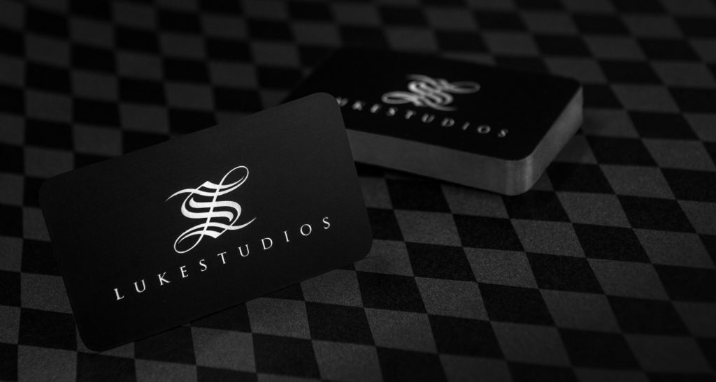 Business cards for a commercial photography studio photographed neatly with the logo shining